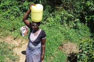 The Water Project: Mbande Community, Handa Spring -  Sarah Wamalwa Carrying Water