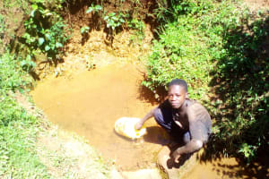 The Water Project: Lwangele Community, Machayo Spring -  Fetching Water