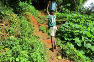 The Water Project: Tintafor, Fire Force Barracks Community -  Carrying Water