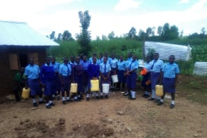 The Water Project: Sipande Secondary School -  Students Posing With Their Water Containers
