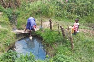 The Water Project: Chebwayi B Community, Wambutsi Spring -  Fetching Water