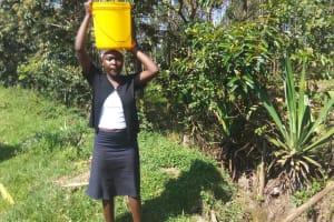 The Water Project: Matsakha Community, Mbakaya Spring -  Maurine Carrying Water