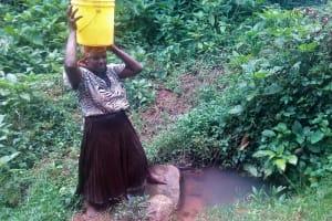 The Water Project: Koloch Community, Solomon Pendi Spring -  Carrying Water