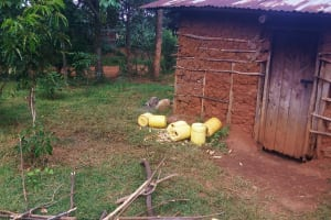 The Water Project: Shina Primary School -  Water Containers Left By The Kitchen