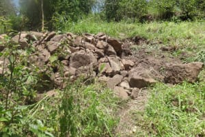 The Water Project: Masera Community, Salim Hassan Spring -  Stones Used For Construction