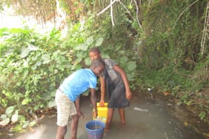 The Water Project: Tulun Community, 10 Tulon Road -  Fetching Water