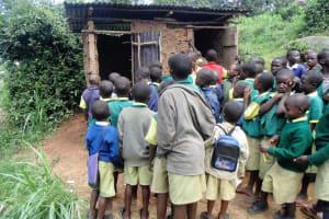 The Water Project: Gemeni Salvation Primary School -  Boys Queue At Latrines