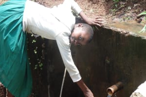 The Water Project: Gemeni Salvation Primary School -  Girl Fills Jerrycan At Spring