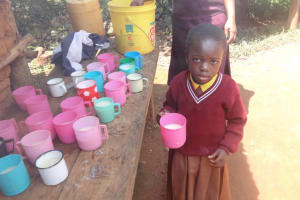 The Water Project: Shihalia Primary School -  A Pupil Poses With Her Porridge