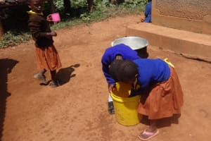 The Water Project: Shihalia Primary School -  Pupils Wash Hands In A Bucket