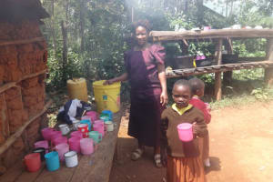 The Water Project: Shihalia Primary School -  Schools Cook At The Kitchen Issuing Porridge To Pupils