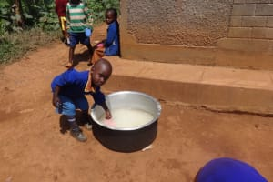 The Water Project: Shihalia Primary School -  Student Scoops Water