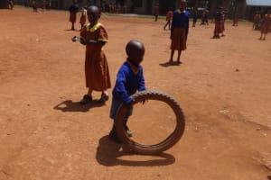 The Water Project: Shihalia Primary School -  Young Boy Plays With Tire