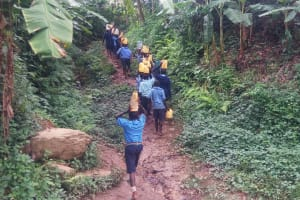 The Water Project: Shihimba Primary School -  Carrying Water Back Up The Hill