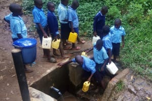 The Water Project: Shihimba Primary School -  Students At The Spring