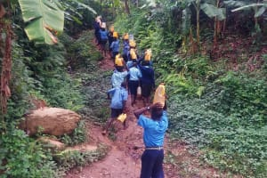 The Water Project: Shihimba Primary School -  Students Carrying Water To School From The Spring