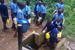 The Water Project: Shihimba Primary School -  Collecting Water At Spring