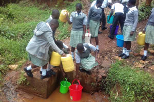 The Water Project: Precious School Kapsambo Secondary -  Students Collect Water From Protected Spring