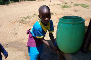 The Water Project: Emukangu Primary School, Shibuli -  Girl Washes Her Hands