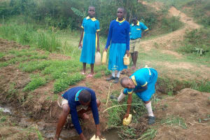 The Water Project: Emukangu Primary School, Shibuli -  Students Fetching Water At A Seasonal Passing Stream