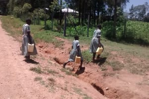 The Water Project: St. Joseph Eshirumba Primary School -  Girls Cross Road With Water Containers