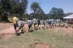 The Water Project: St. Joseph Eshirumba Primary School -  Students Bring Water To School