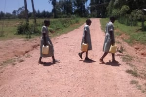 The Water Project: St. Joseph Eshirumba Primary School -  Students Cross Road With Water