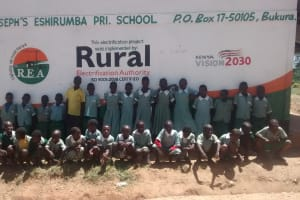 The Water Project: St. Joseph Eshirumba Primary School -  Students In Front Of School Sign
