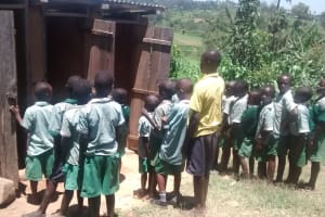 The Water Project: St. Joseph Eshirumba Primary School -  Students Line Up Waiting To Use The Limited Facilities
