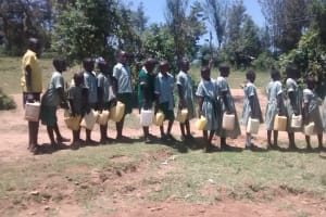 The Water Project: St. Joseph Eshirumba Primary School -  Students Line Up With Water Containers