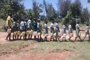 The Water Project: St. Joseph Eshirumba Primary School -  Students Pose With Water Containers