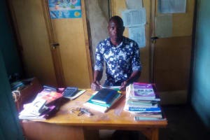 The Water Project: Eshisenye Primary School -  Senior Teacher In His Office
