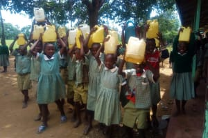 The Water Project: Eshisenye Primary School -  Students Pose With Water Containers