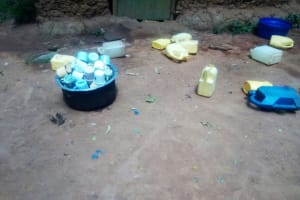 The Water Project: Eshisenye Primary School -  Water Containers And Cups Lying On The Floor