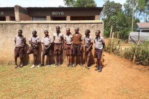The Water Project: Shitaho Community School -  Boys Stand In Front Of Latrines