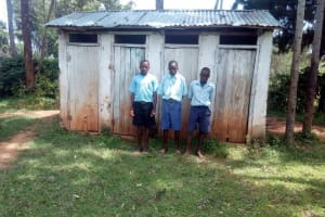 The Water Project: Matsigulu Primary School -  Boys Stand In Front Of Latrines
