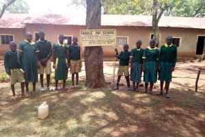 The Water Project: Imbale Primary School -  Students Post With Sign