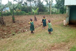The Water Project: Imbale Primary School -  Young Girls In Front Of Latrines