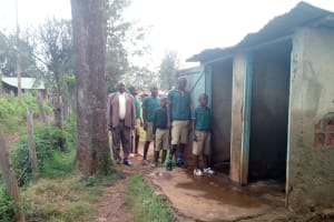 The Water Project: Imbale Primary School -  Boys Pose At Their Latrines