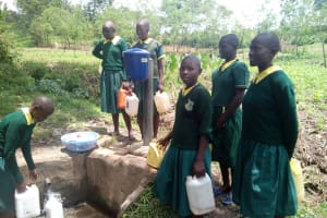 The Water Project: Imbale Primary School -  Girls Collect Water At Spring