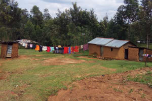 The Water Project: Matsakha Community, Siseche Spring -  Homestead With Clothes Hanging To Dry