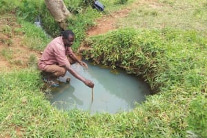 The Water Project: Matsakha Community, Siseche Spring -  Testing Spring Depth