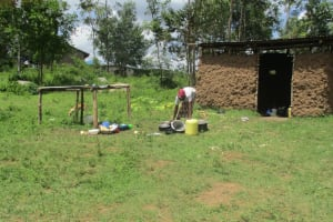 The Water Project: Luvambo Community, Timona Spring -  Cleaning Dishes Outside
