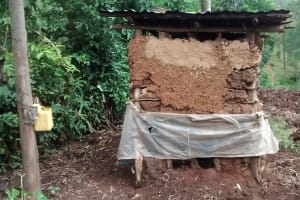 The Water Project: Luvambo Community, Timona Spring -  Latrine And Improvized Handwashing Station
