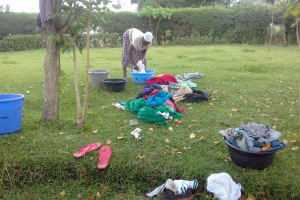The Water Project: Musutsu Community, Mwashi Spring -  A Lady Washing Her Households Cloths