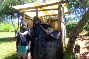 The Water Project: Musutsu Community, Mwashi Spring -  Alice Stands Beside Her Househols Latrine