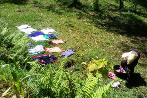 The Water Project: Musutsu Community, Mwashi Spring -  Clothes Dry Laid Out On The Lawn