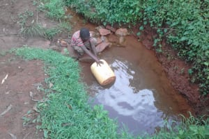 The Water Project: Musutsu Community, Mwashi Spring -  Filling Jerrycan At The Spring
