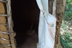 The Water Project: Chegulo Community, Yeni Spring -  Latrine Interior