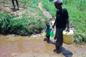 The Water Project: Chegulo Community, Yeni Spring -  Mother And Child Arrive At Yeni Spring